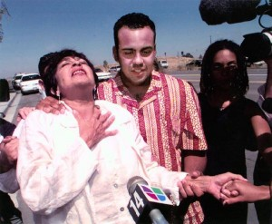 Dylcia Pagan, freed from prison after 19 years, on the arm of her son, Ernesto Gomez-Gomez. Gomez-Gomez