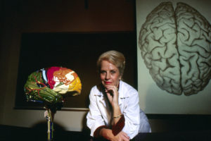 Marian Diamond poses for a photograph with model brains at University of California, Berkeley in Berkeley, Calif. on Aug. 1, 1984.
